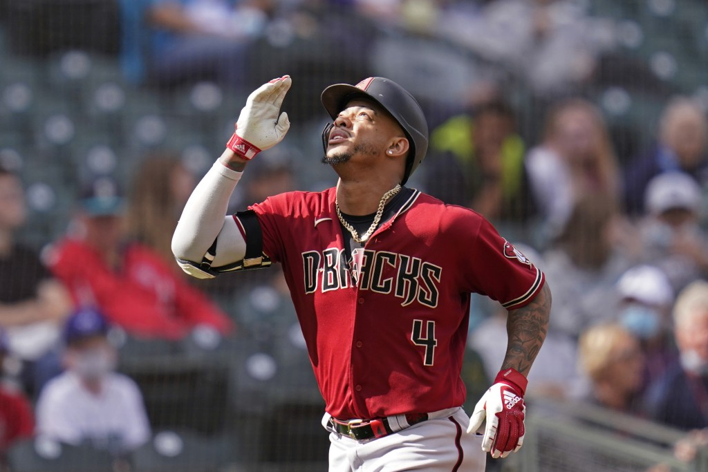Arizona Diamondbacks' Ketel Marte motions as he heads home on his solo home run against the Seattle Mariners in the seventh inning of a baseball game ...