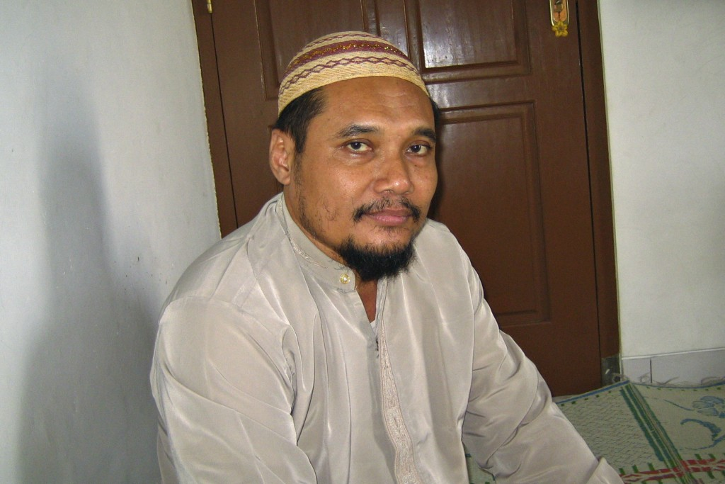 FILE - In this March 16, 2007 file photo, militant cleric Abu Rusdan sits in his family home during an interview with The Associated Press in Kudus, C...
