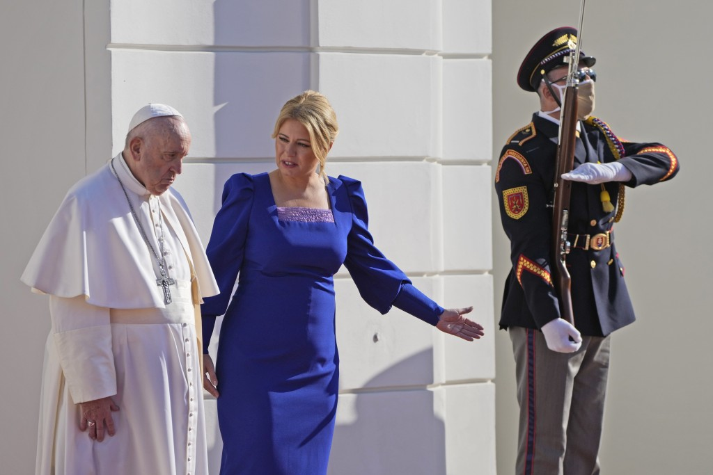 Pope Francis, flanked by Slovakian President Zuzana Caputova, right, attends a welcoming ceremony at the presidential palace in Bratislava, Slovakia, ...