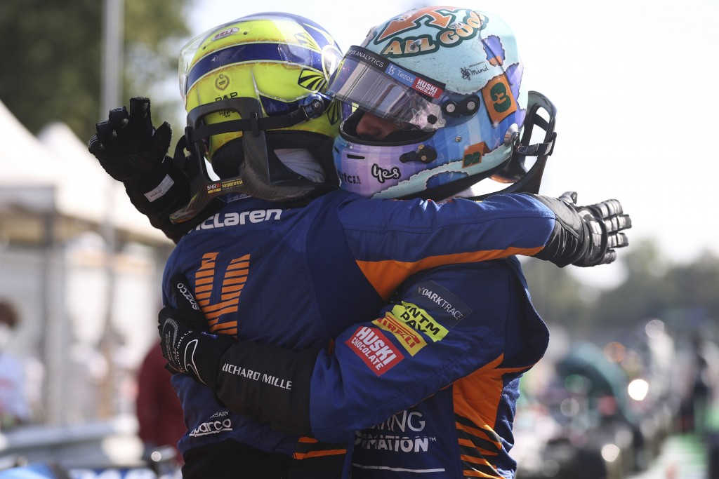Mclaren driver Daniel Ricciardo of Australia, right, celebrates after with second placed Mclaren driver Lando Norris of Britain after winning the Ital...