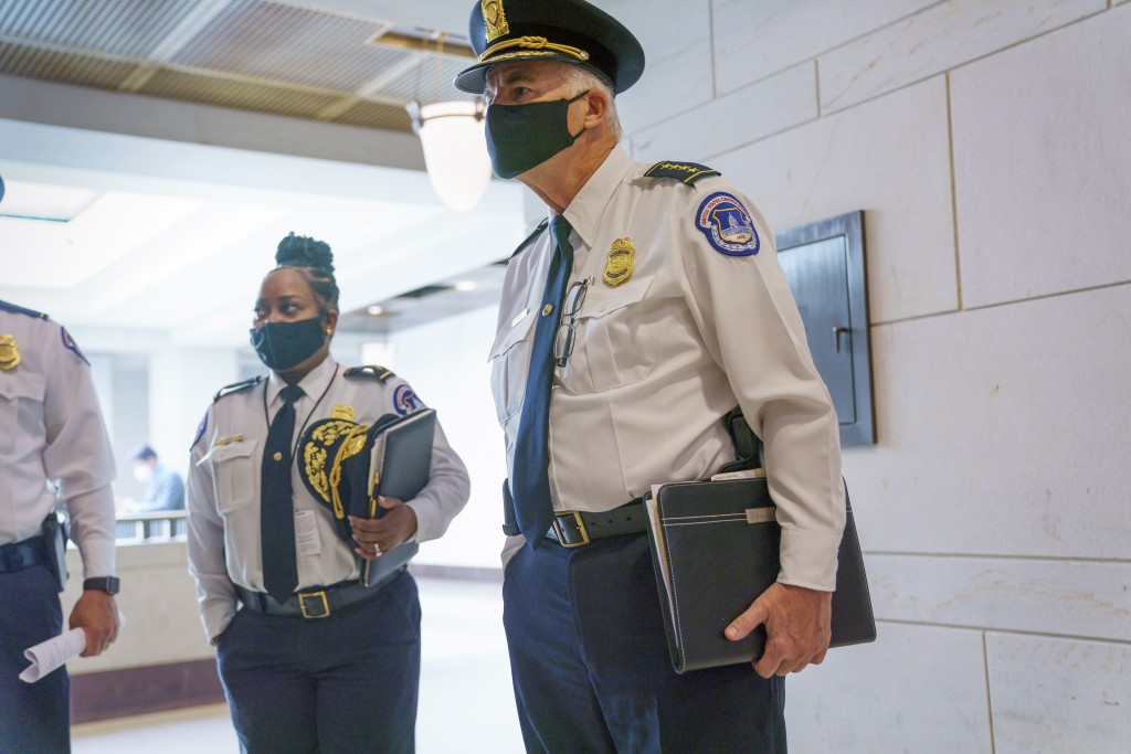 U.S. Capitol Police Chief Thomas Manger, joined at left by Assistant Chief Yogananda Pittman, heads to a closed-door meeting with congressional leader...