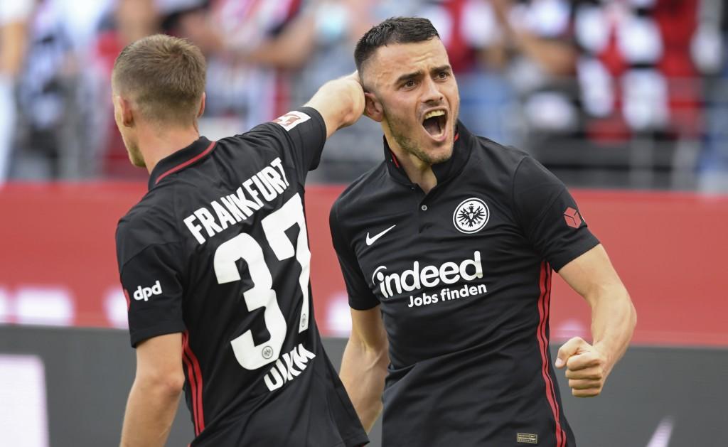 Frankfurt's Filip Kostic, right, celebrates with Erik Durm after scoring during the German Bundesliga soccer match between Eintracht Frankfurt and VfB...