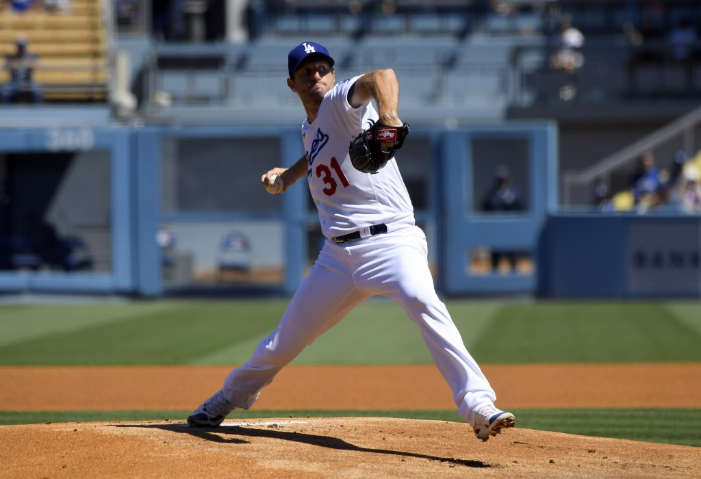 Los Angeles Dodgers starting pitcher Max Scherzer throws in the first inning against the San Diego Padres in a baseball game Sunday, Sept. 12, 2021, i...
