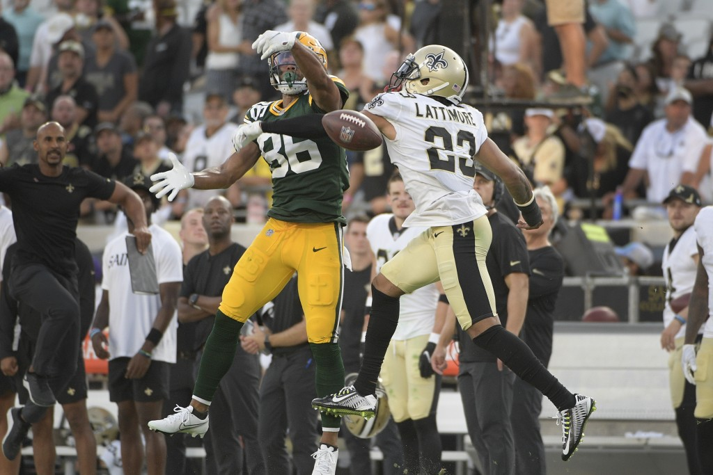 New Orleans Saints cornerback Marshon Lattimore (23) breaks up a pass intended for Green Bay Packers wide receiver Malik Taylor, left, during the seco...