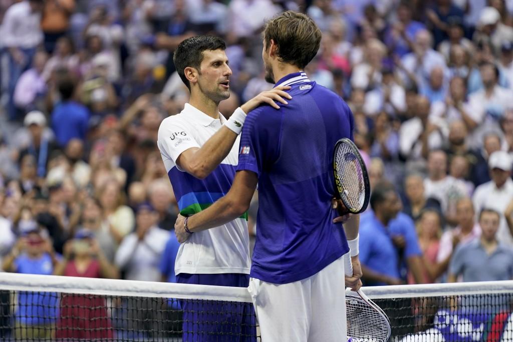 Novak Djokovic, of Serbia, left, congratulates Daniil Medvedev, of Russia, after Medvedev won the men's singles final of the US Open tennis championsh...