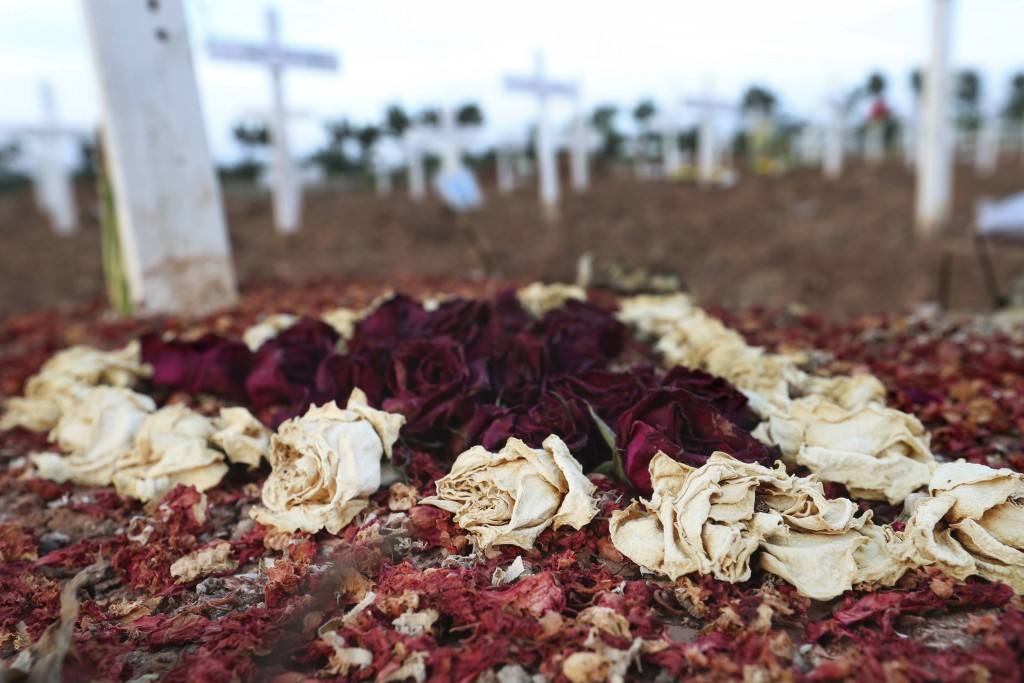 Dried flowers are seen on the grave of a COVID-19 victim at Rorotan Cemetery in Jakarta, Indonesia, Wednesday, Sept. 1, 2021. In the graveyard on Jaka...