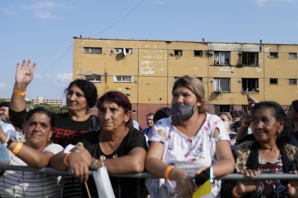 Residents wait for Pope Francis arrival to meet members of the Roma community at Lunik IX, in Kosice, Slovakia, Tuesday, Sept. 14, 2021, the biggest o...
