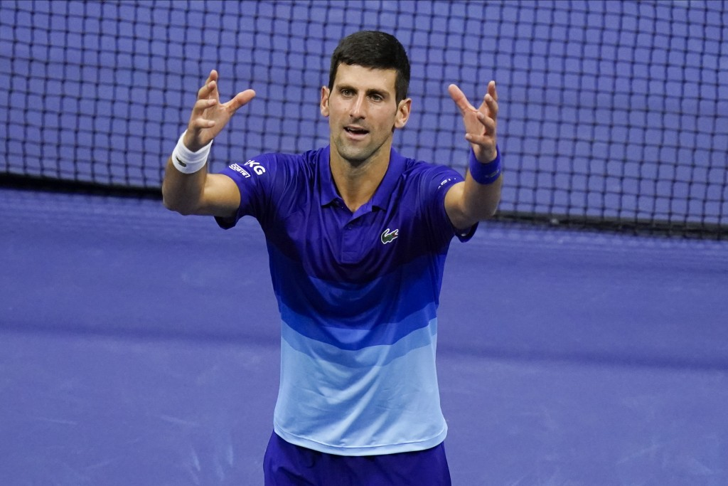 Novak Djokovic, of Serbia, reacts after defeating Alexander Zverev, of Germany, during the semifinals of the US Open tennis championships, Friday, Sep...