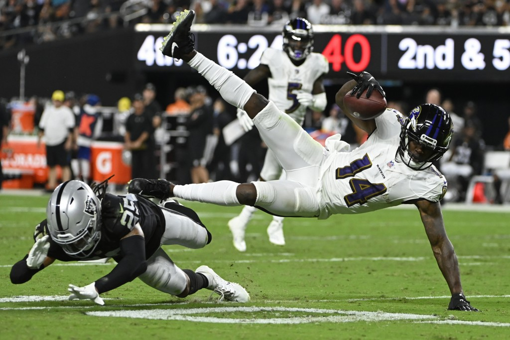 Las Vegas Raiders safety Tre'von Moehrig (25) tackles Baltimore Ravens wide receiver Sammy Watkins (14) during the second half of an NFL football game...