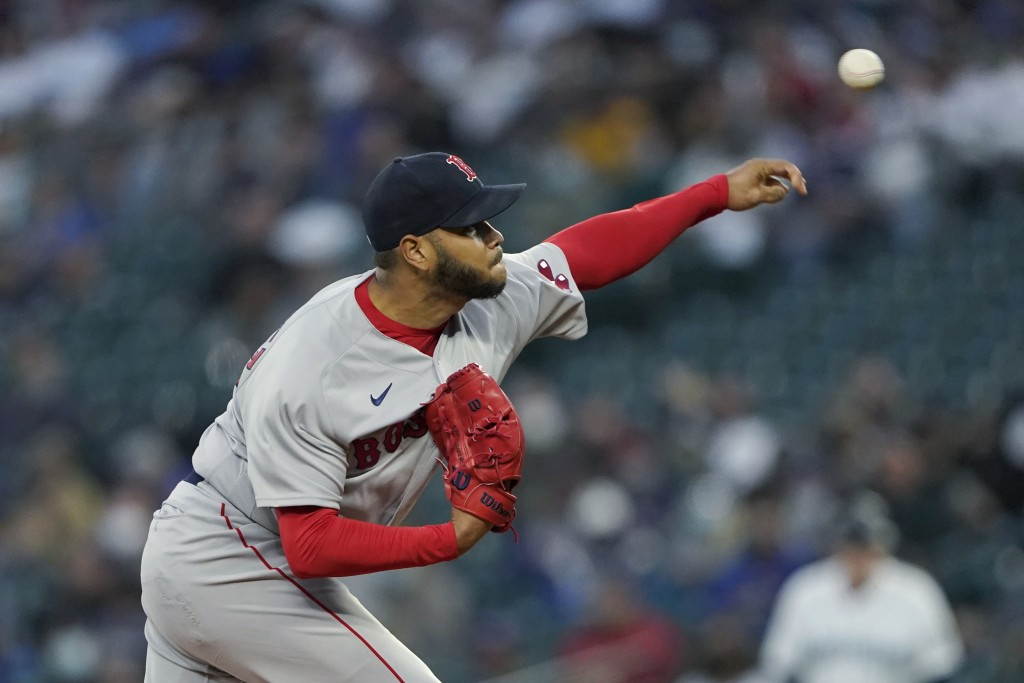 Boston Red Sox starting pitcher Eduardo Rodriguez throws against the Seattle Mariners during the first inning of a baseball game, Monday, Sept. 13, 20...