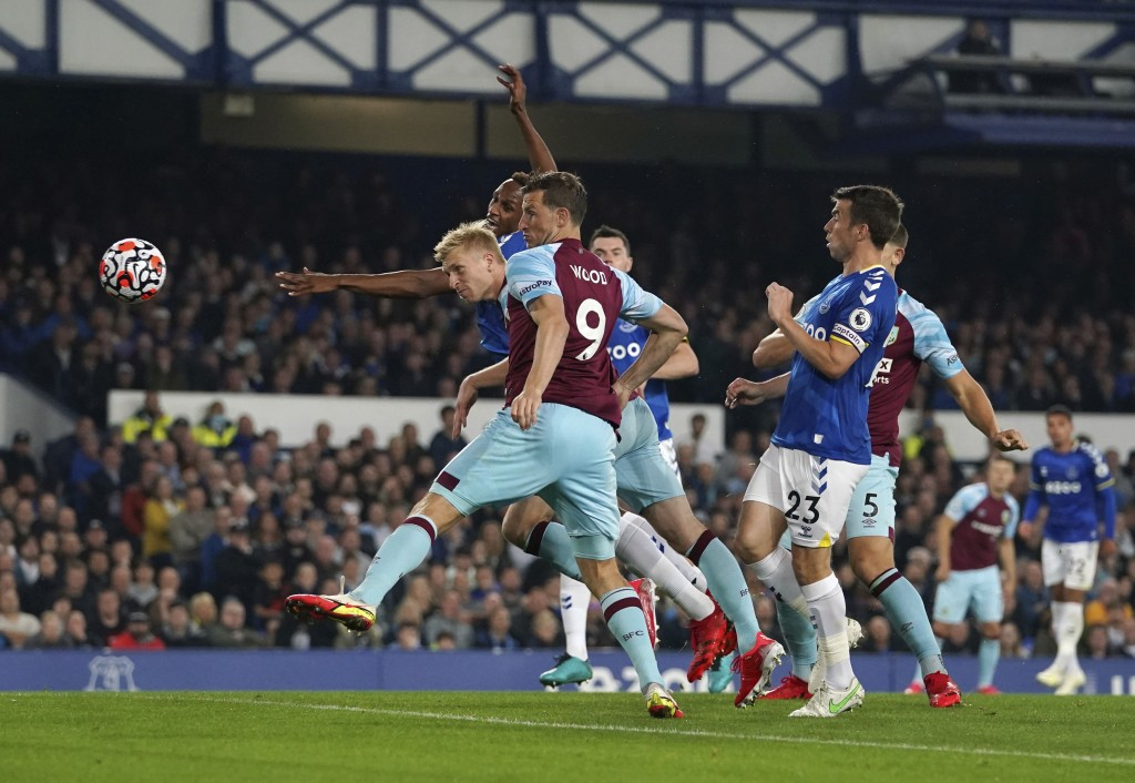 Burnley's Ben Mee scores their side's first goal of the game during their English Premier League soccer match against Everton at Goodison Park, Liverp...