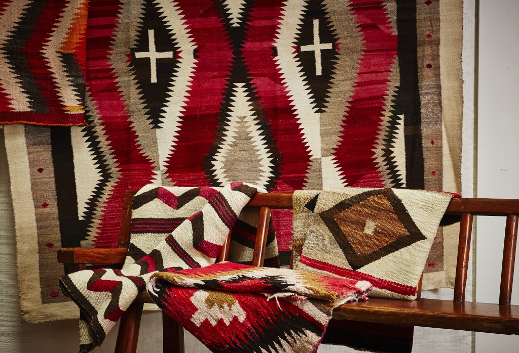 """This photo provided by Upstate Rug Supply shows a selection of Navajo rugs. """"The Navajo are among the finest rug makers in the world, featuring loom w..."""