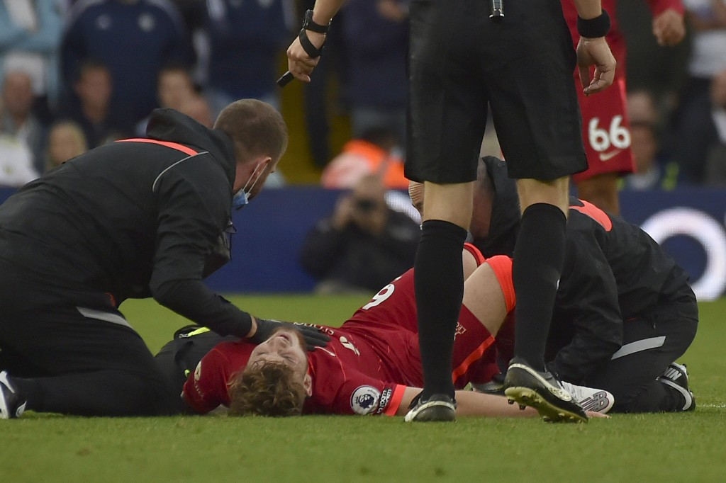 Liverpool's Harvey Elliott is assisted after he got injured in a clash with Leeds United's Pascal Struijk during the English Premier League soccer mat...