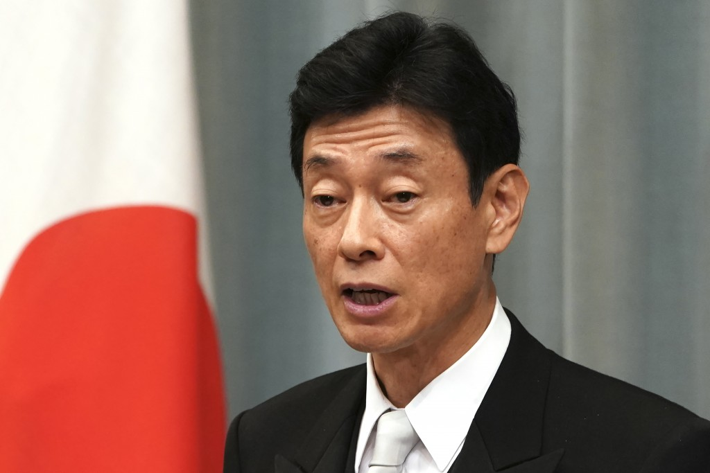 FILE - In this Sept. 11, 2019, file photo, newly appointed Economy and Fiscal Policy Minister Yasutoshi Nishimura speaks during a press conference at ...