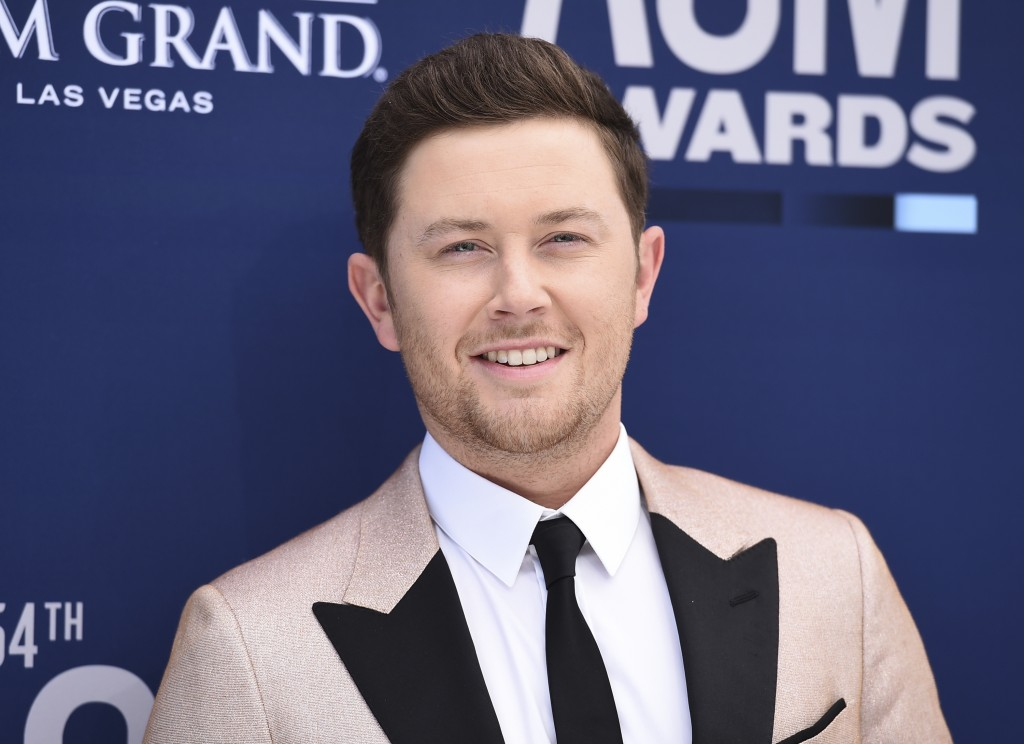 FILE - In this April 7, 2019, file photo, Scotty McCreery arrives at the 54th annual Academy of Country Music Awards at the MGM Grand Garden Arena in ...