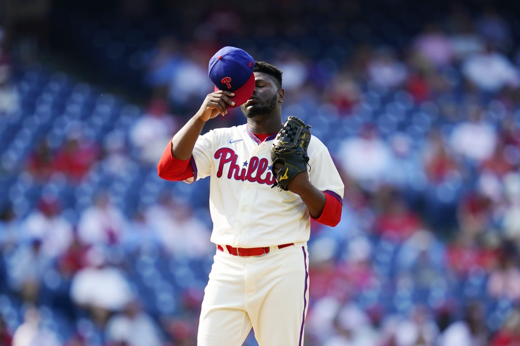 Philadelphia Phillies pitcher Hector Neris reacts after giving up a two-run home run to Colorado Rockies' Garrett Hampson during the seventh inning of...