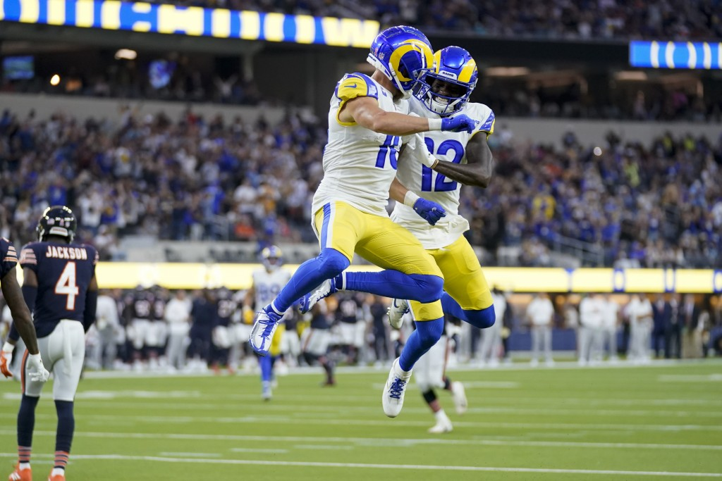 Los Angeles Rams wide receiver Cooper Kupp, center right, celebrates with teammate wide receiver Van Jefferson, right, after scoring a touchdown durin...