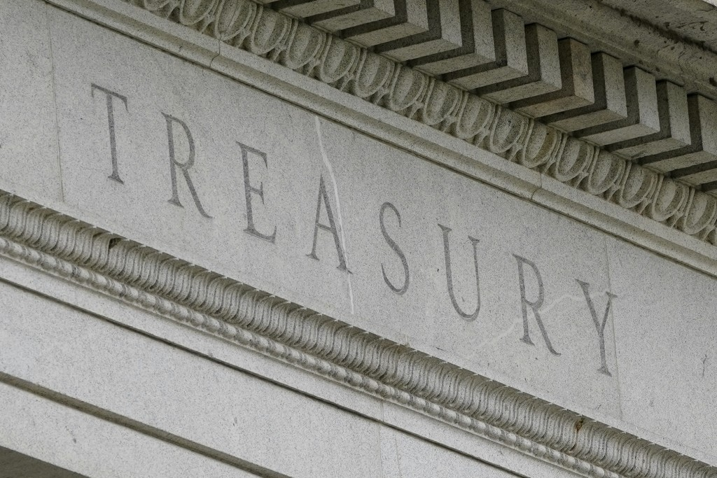 FILE - This May 4, 2021 file photo shows the Treasury Building in Washington.  The U.S. budget deficit rose to $2.71 trillion through August, on track...