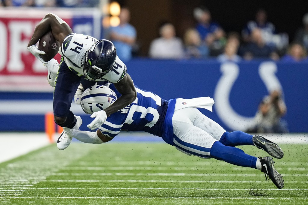 Seattle Seahawks wide receiver DK Metcalf (14) is tackled by Indianapolis Colts safety Khari Willis (37) during the second half of an NFL football gam...