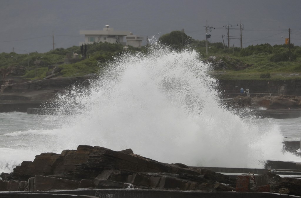 A high wave hits ashore as Typhoon Chanthu approaches to Taiwan in Keelung, New Taipei City, Taiwan, Saturday, Sept. 11, 2021. Taiwan's weather bureau...