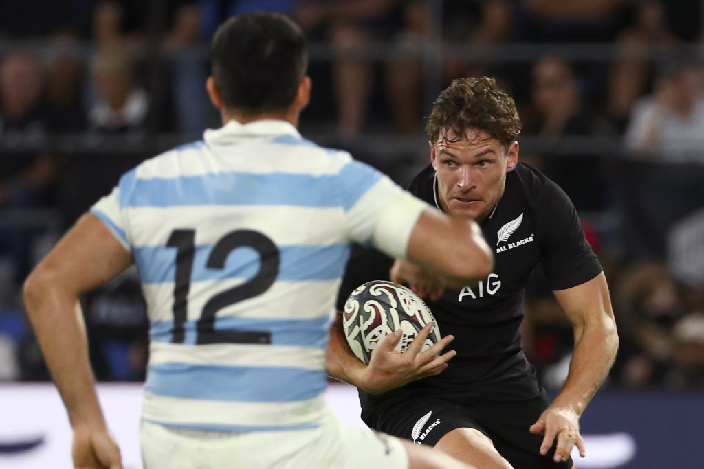 New Zealand's George Bridge, right, looks to get past Argentina's Jeronimo de la Fuente during their Rugby Championship match on Sunday, Sept. 12, 202...