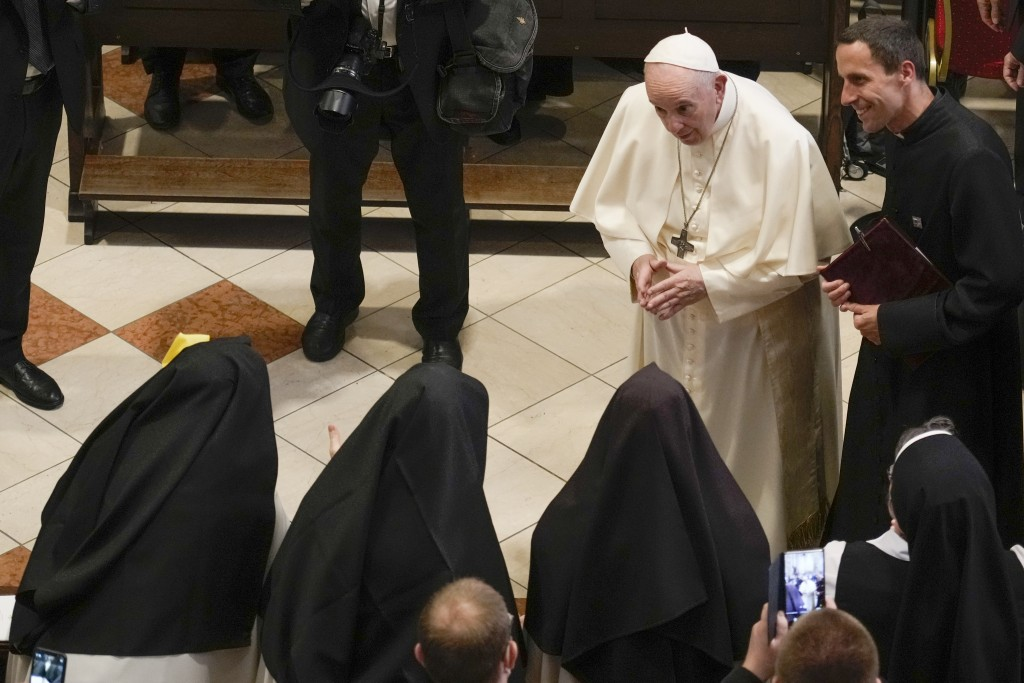 Pope Francis greets nuns as he arrives for a meeting with priests, religious men and women, seminarians and catechists, at the Cathedral of Saint Mart...