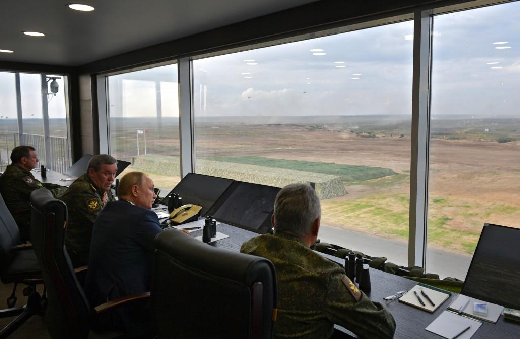 Russian President Vladimir Putin, second right, Russian Defense Minister Sergei Shoigu, right, and Russian General Staff Valery Gerasimov, second left...