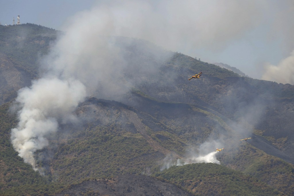 Hydroplanes operate on a wildfire in Estepona, in Malaga province, Spain, Saturday, Sept. 11, 2021. Soldiers were deployed in southeastern Spain Sunda...