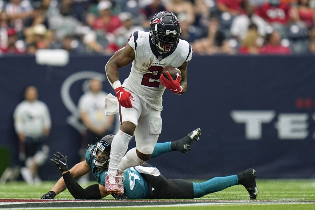 Houston Texans running back Mark Ingram II (2) rushes for a first down as Jacksonville Jaguars safety Andrew Wingard defends during the second half of...