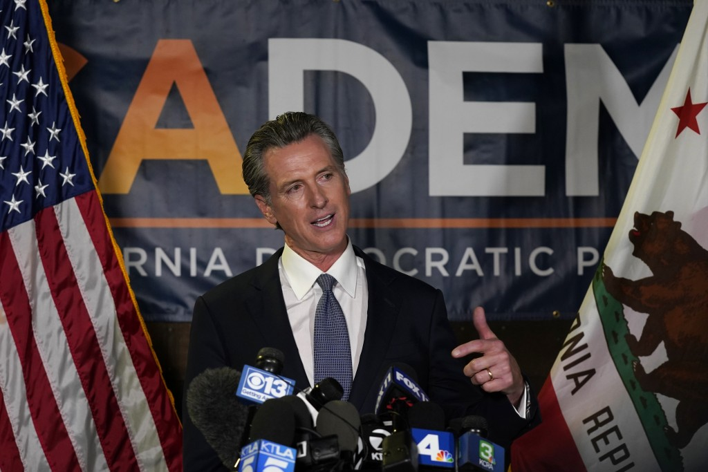 California Gov. Gavin Newsom addresses reporters after beating back the recall that aimed to remove him from office at the John L. Burton California D...