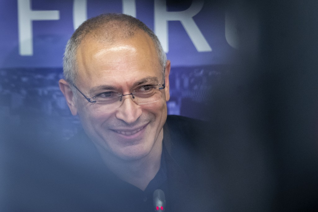 FILE - In this Aug. 20, 2021, file photo, Russian opposition figure and former owner of the Yukos Oil Company Mikhail Khodorkovsky smiles during a new...