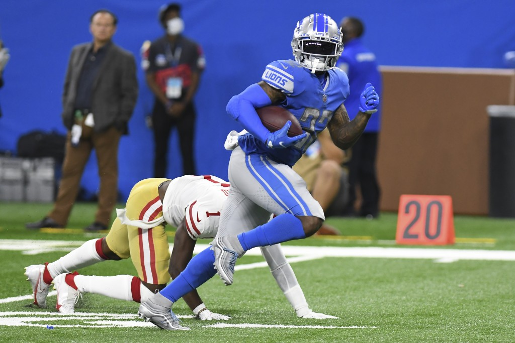 Detroit Lions running back D'Andre Swift (32) runs for a 43 touchdown reception against the San Francisco 49ers in the second half of an NFL football ...