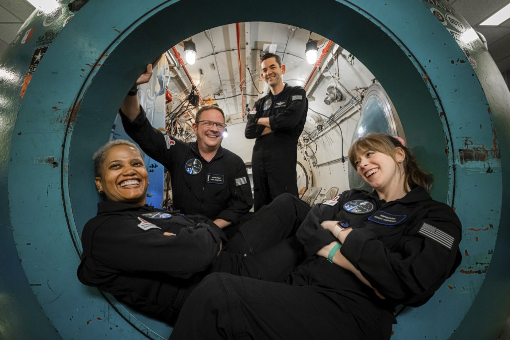 In this July 2, 2021 photo provided by John Kraus, from left, Sian Proctor, Chris Sembroski, Jared Isaacman and Hayley Arceneaux pose for a photo at D...