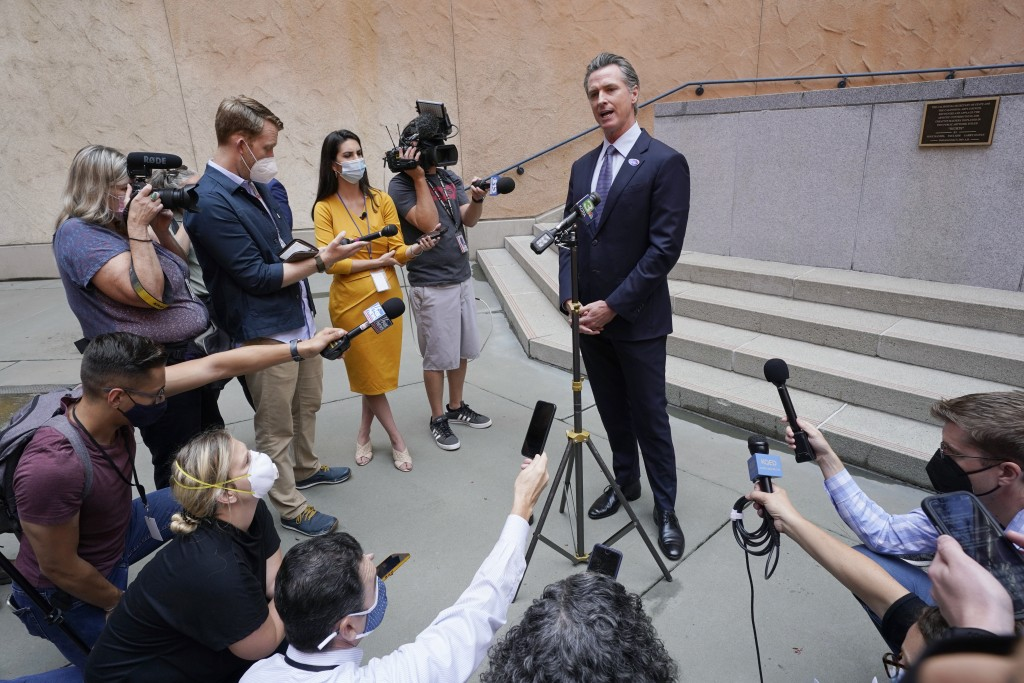FILE - In this Sept. 10, 2021, file photo California Gov. Gavin Newsom responds to a question while meeting with reporters after casting his recall ba...