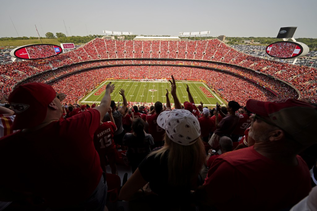 Fans do the tomahawk chop as the Kansas City Chiefs and the Cleveland Browns play during the first half of an NFL football game at Arrowhead Stadium, ...