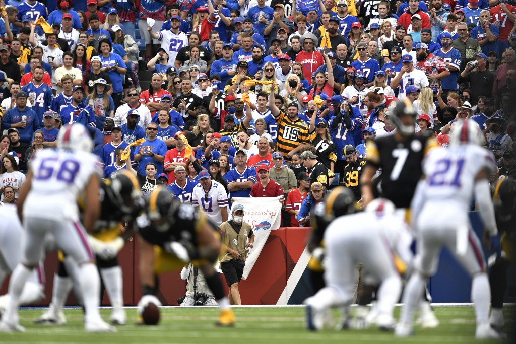 Fans watch the first half of an NFL football game between the Buffalo Bills and the Pittsburgh Steelers in Orchard Park, N.Y., Sunday, Sept. 12, 2021....