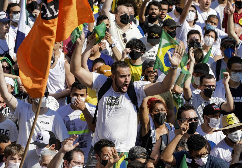 People gather at Paulista Avenue during a protest against President Jair Bolsonaro, demanding his resignation for mishandling the pandemic, corruption...