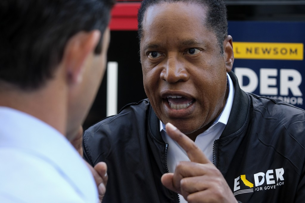 Republican conservative radio show host Larry Elder argues with a TV reporter during an interview after visiting Philippe The Original Deli during a c...