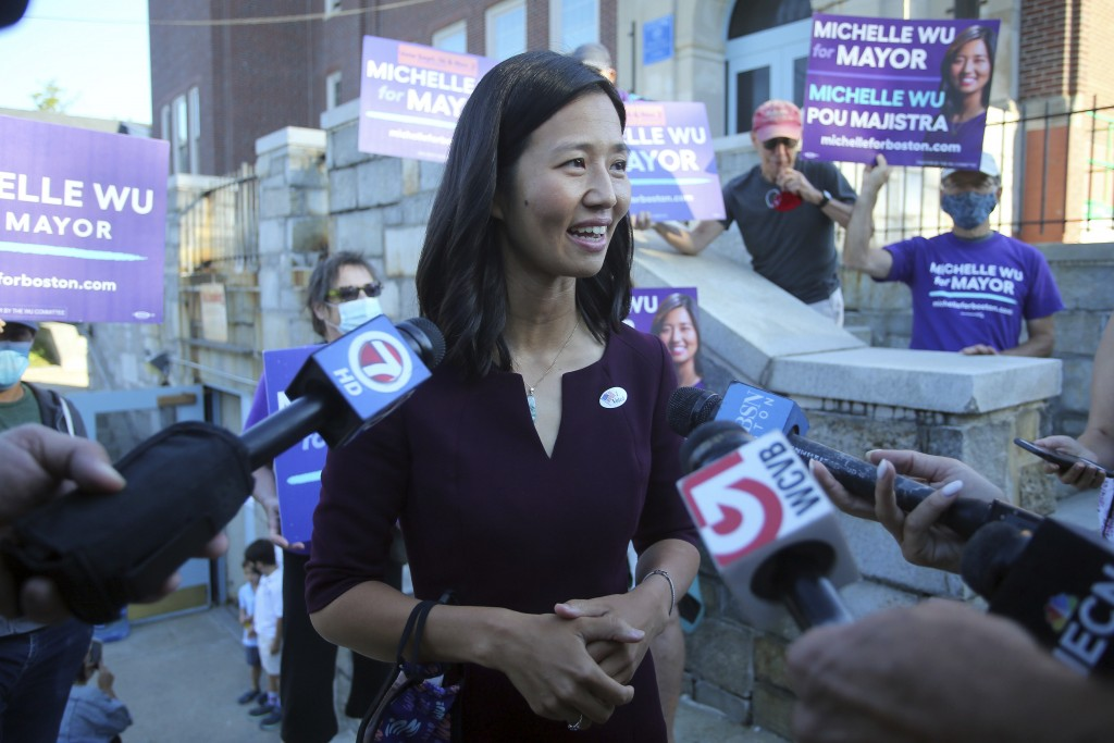 Boston mayoral candidate Michelle Wu speaks with the media after casting her ballot in the Mayoral race on Election Day, at the Phineas Bates Elementa...