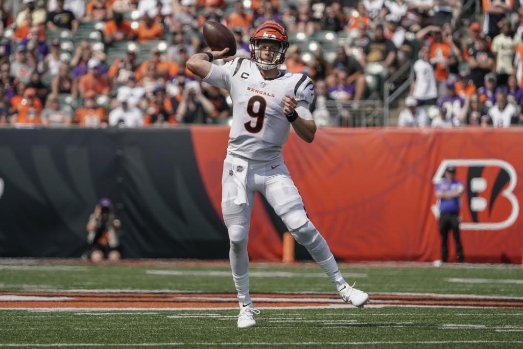 Cincinnati Bengals quarterback Joe Burrow (9) passes against the Minnesota Vikings during the second half of an NFL football game, Sunday, Sept. 12, 2...