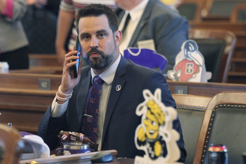 FILE - In this file photo from Monday, May 3, 2021, Kansas state Rep. Mark Samsel, R-Wellsville, talks on his cellphone ahead of the House's daily ses...