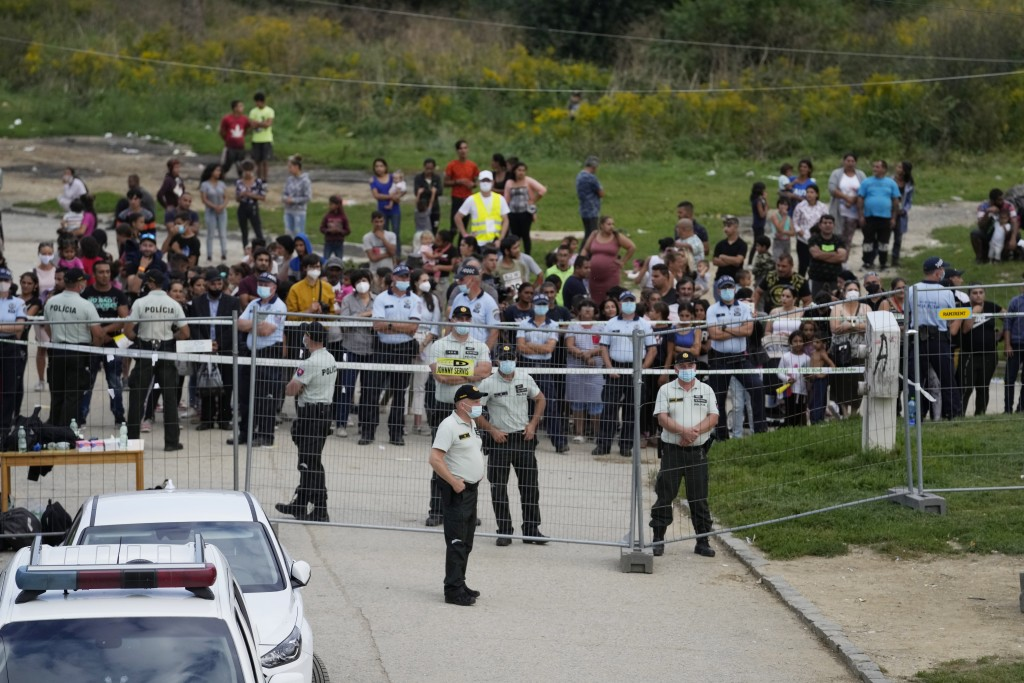 Police patrol fences as Pope Francis meets members of the Roma community at Lunik IX, in Kosice, Slovakia, Tuesday, Sept. 14, 2021, the biggest of abo...