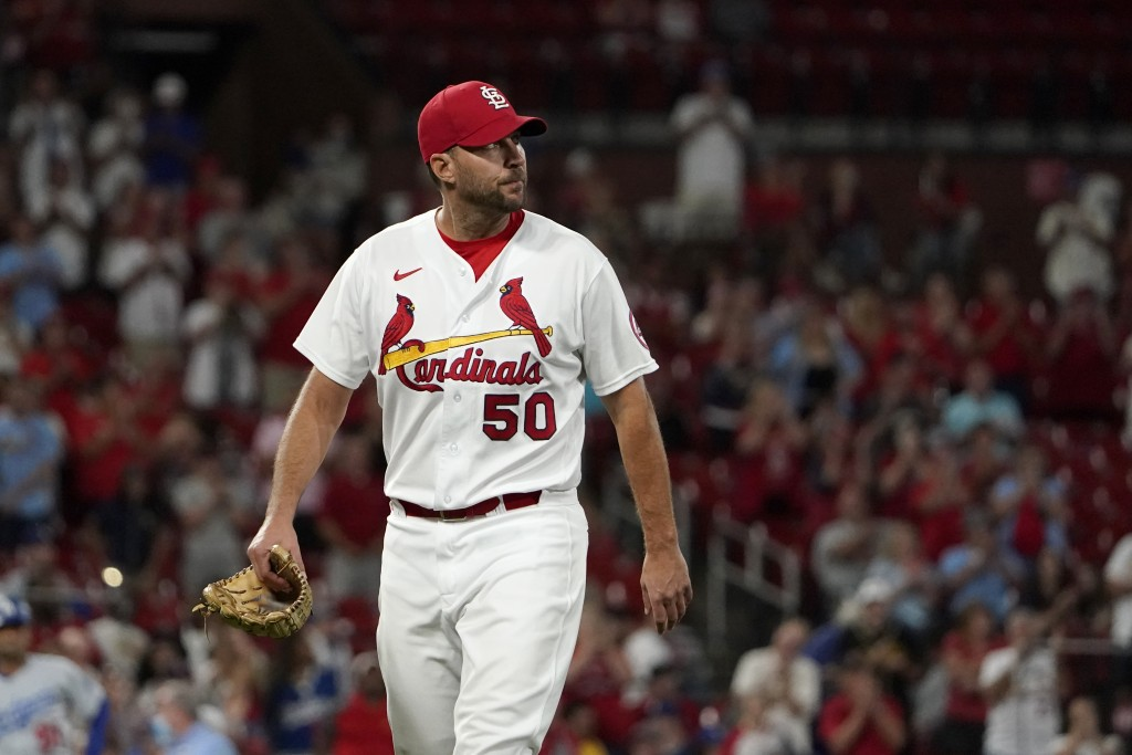 St. Louis Cardinals starting pitcher Adam Wainwright walks off the field after being removed during the ninth inning of a baseball game Wednesday, Sep...