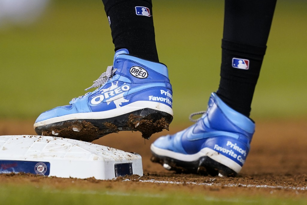 Miami Marlins' Jazz Chisholm Jr., wears Oreo-themed shoes as he stands on first base during the fifth inning of a baseball game against the Washington...
