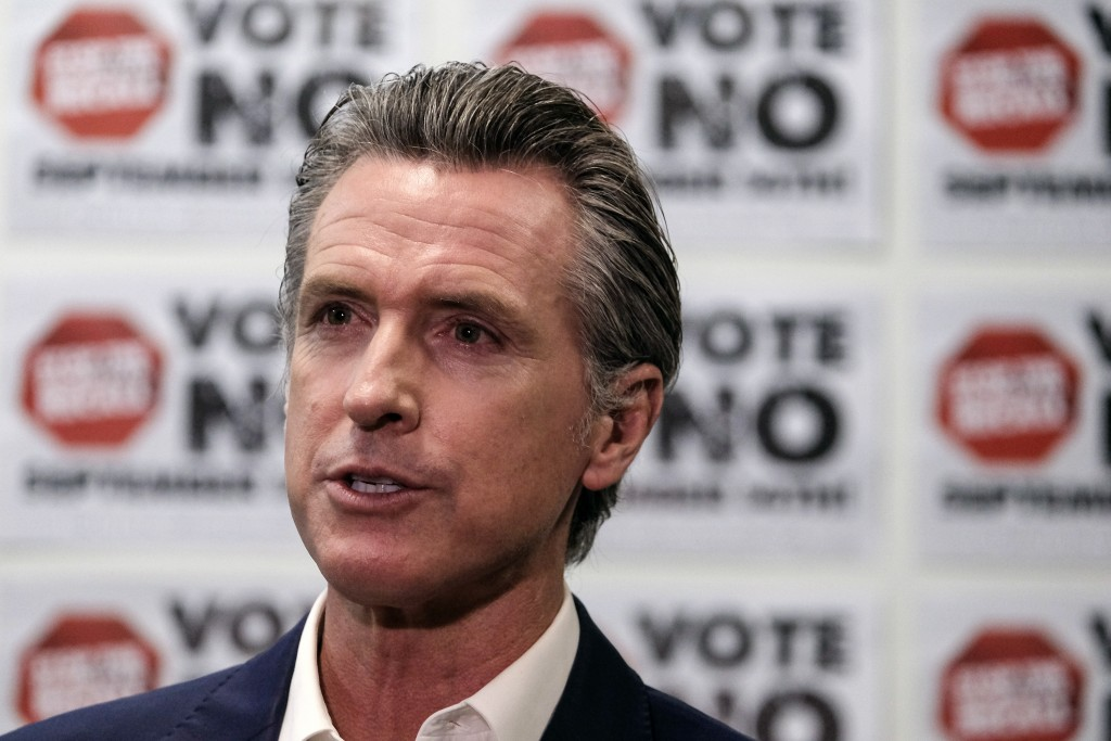 California Gov. Gavin Newsom is photographed during a TV interview before a rally against the California gubernatorial recall election on Sunday, Sept...