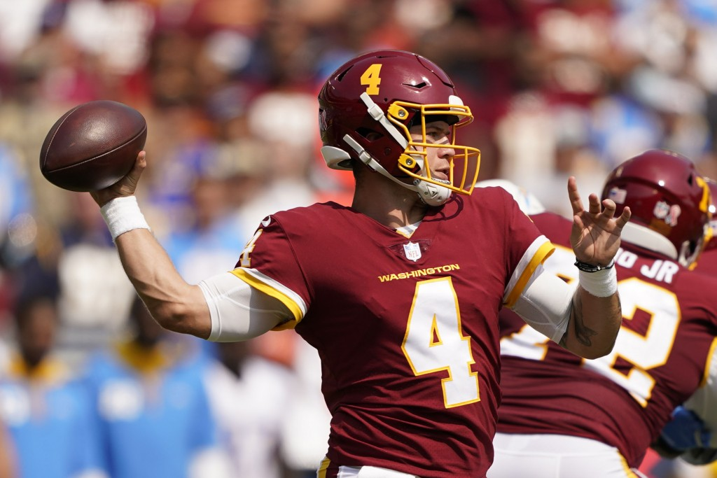 Washington Football Team quarterback Taylor Heinicke (4) throws the ball against the Los Angeles Chargers during the first half of an NFL football gam...
