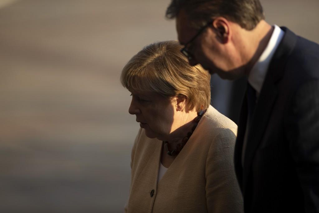 German Chancellor Angela Merkel, center, is accompanied by Serbia's president Aleksandar Vucic during her visit to Belgrade, Serbia, Monday, Sept. 13,...