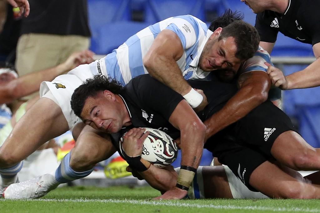 CORRECT'S NEW ZEALAND PLAYER'S NAME - New Zealand's David Havili, left, drives through Argentina's Bautista Delguy during their Rugby Championship mat...