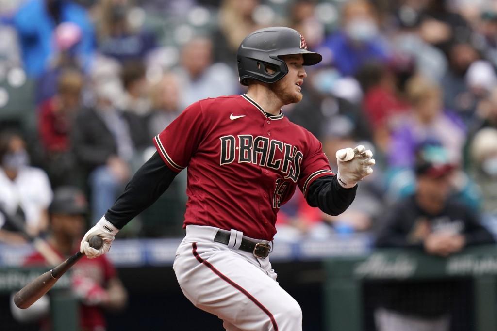 Arizona Diamondbacks' Josh VanMeter singles to drive in a run against the Seattle Mariners in the third inning of a baseball game Sunday, Sept. 12, 20...