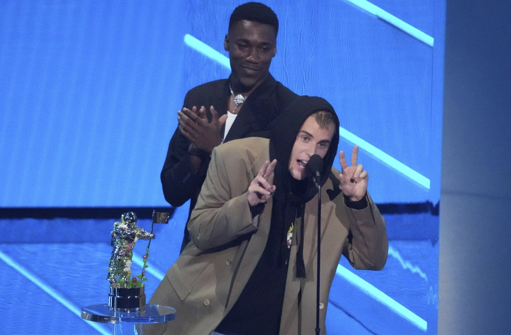 """Justin Bieber, right, and Giveon accept the award for best pop song for """"Peaches"""" at the MTV Video Music Awards at Barclays Center on Sunday, Sept. 12..."""